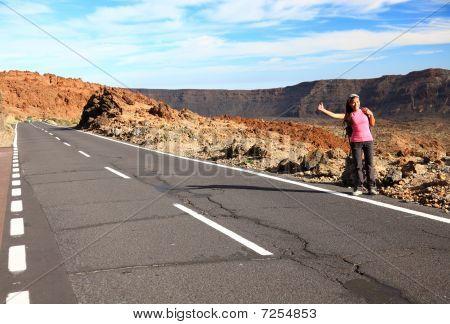Woman Backpacking / Hitchhiking On Teide, Tenerife