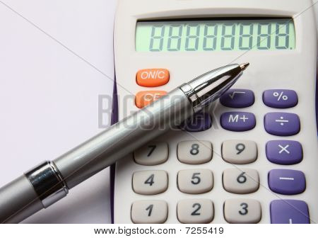 White Colorful Calculator With A Siver Pen On White