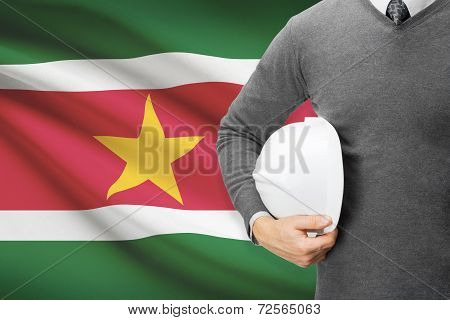 Architect With Flag On Background  - Suriname