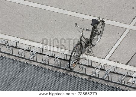 Single Old Bicycle Parking in a Rack