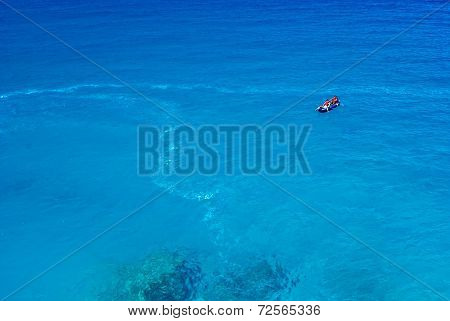 Boat With People In The Sea