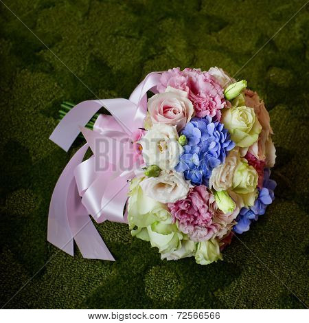 Bouquet Of Blooming Colorful Flowers On A Green Carpet Background.