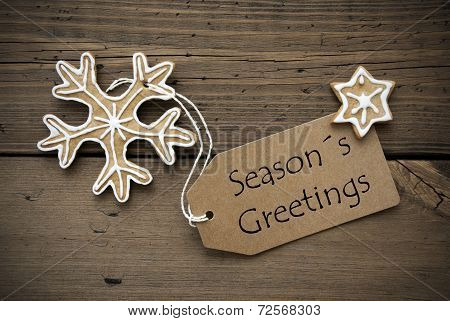 Season's Greetings On A Banner With Ginger Bread Cookies