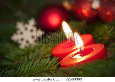 Macro Of Two Burning Candles With Christmas Background