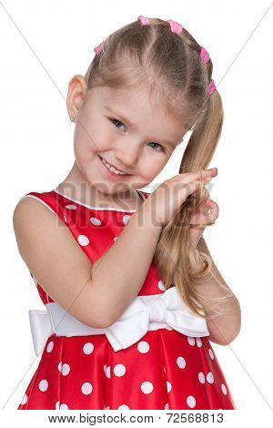 Shy Little Girl In A Red Polka Dot Dress