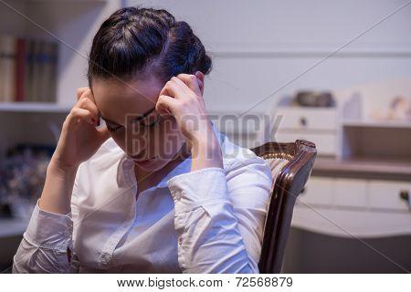 Serious woman wearing white blouse
