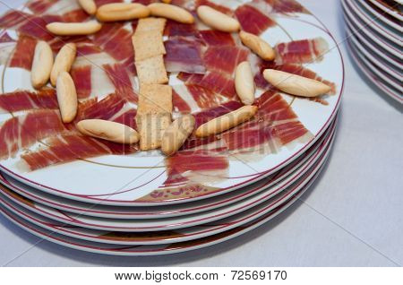 Cured Ham And Some Breadsticks