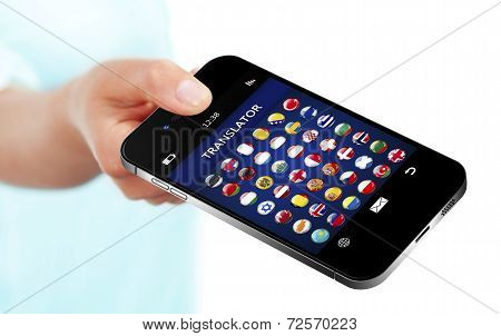 Hand Holding Mobile Phone With Language Translator Application Over White