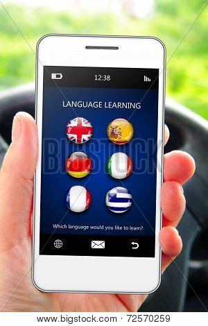 Hand Holding Mobile Phone With Language Learning Application