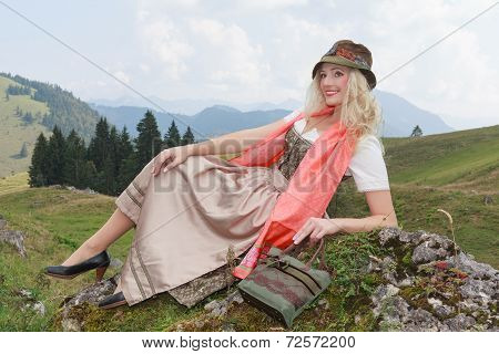 Young woman with fashionable hat and Dirndl, Bavaria, Germany