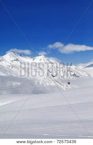 Winter Snowy Mountains And Ski Slope At Nice Day.