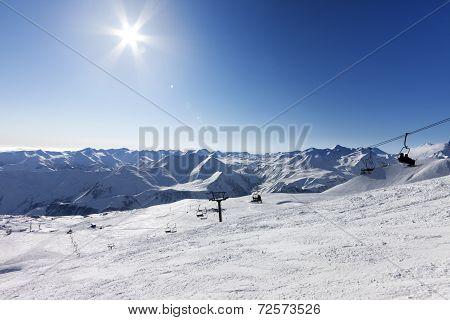 Ski Slope And Sky With Sun