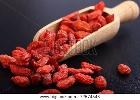 Goji Berries In A Wooden Scoop