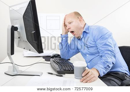 Yawning and tired businessman