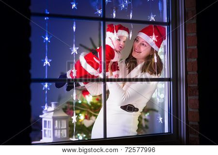 Mother And Baby Dress As Santa