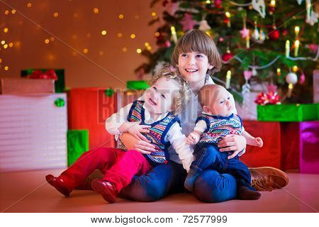 Children Under A Christmas Tree
