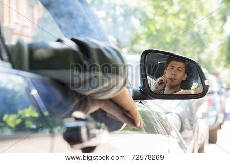 Young Man Reflection On Car Side Mirror