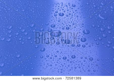 Water Drops On Bright Blue Background