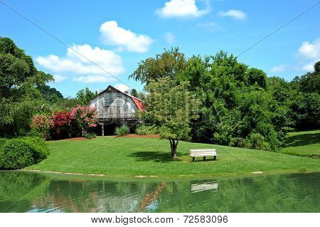 Barn With Pond In Front
