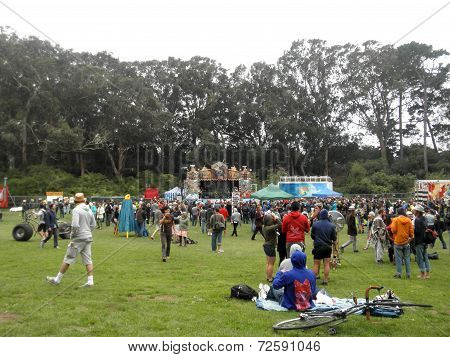 Crowd Of People Talk And Drink Beer In Celebration Of Bicycling At Tour De Fat Concert With Stage An
