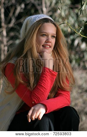 Girl Sitting In Outdoors - Portrait