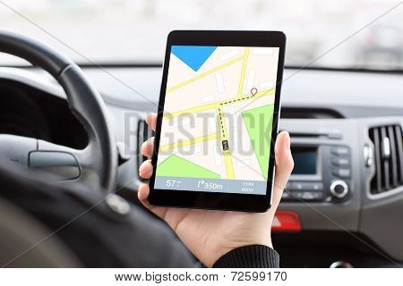 Man Sitting In The Car And Holding A Tablet With Interface Navigator On A Screen