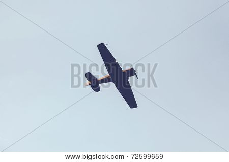 Fighter plane on cloudy sky