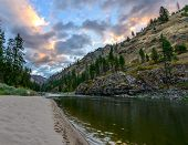 stock photo of boise  - Colorful sky at sunrise in the Salmon River Canyon - JPG