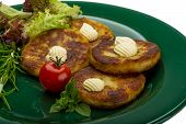 stock photo of hash  - Hash browns with herbs on the plate