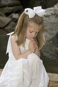 stock photo of forgiven  - Little girl praying outside - JPG