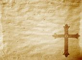 A Medieval Cross On A Worn Piece Of Parchment poster