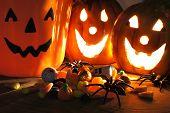 foto of jack-o-lantern  - Halloween night scene with Jack o Lanterns and candy  - JPG