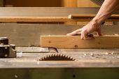 foto of wood craft  - a carpenter work with a wood planer - JPG