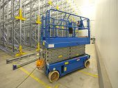 picture of lifted  - Scissor lift aerial work platform in warehouse - JPG