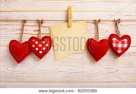 Valentines Vintage Handmade Hearts over Wooden Background.
