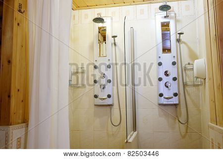 Two showers with hydro massage jets