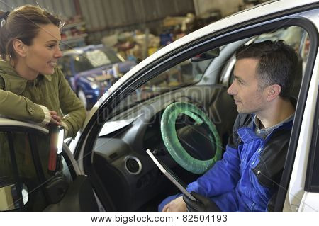 Mechanic doing technical inspection on individual car