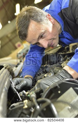 Technician working in auto repair shop