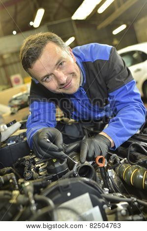 Technician working in auto repair shop