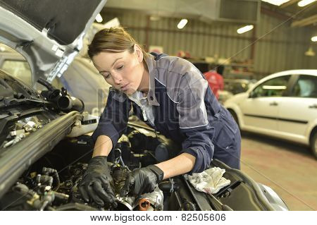 Technician woman working in auto repair workshop