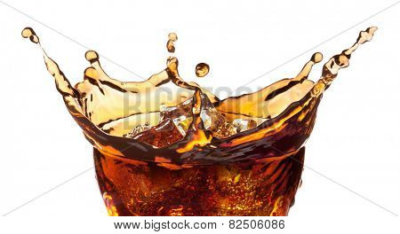 Splash from ice cubes in a glass of cola, isolated on the white background, clipping path included.