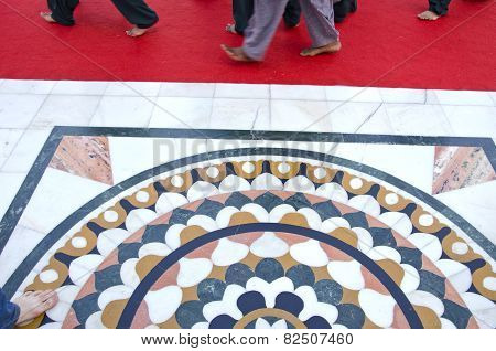 Beautiful Marble Floor And Barefooted Sikh Prayers Foots On Red Carpet
