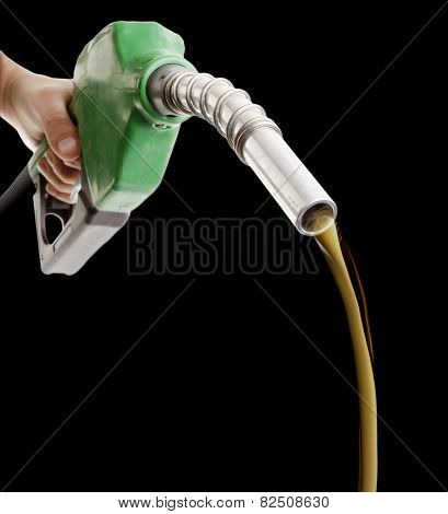 Male hand wasting gas with green pump isolated on black