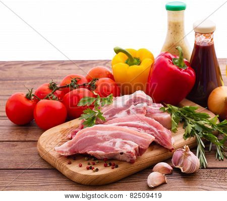 Food. Sliced pieces of raw meat for barbecue with fresh vegetables