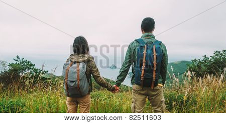 Hiker Couple In Love Enjoying View Of Sea