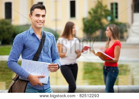 Outdoor portrait of a student in front of his school