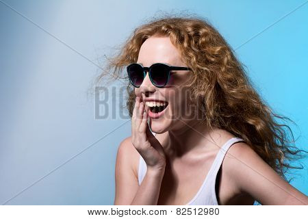 Pretty Young Emotional Girl In Sunglasses Looking To The Side