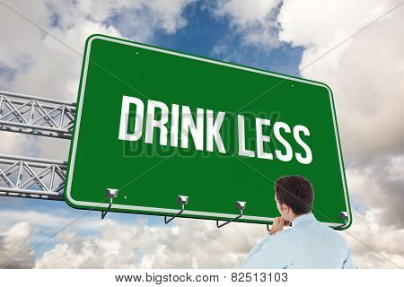The word drink less and thoughtful businessman with hand on chin against blue sky with white clouds