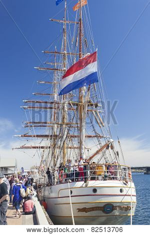Tourists visiting a tall ship