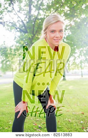 Active smiling blonde pausing after a run against new year new shape